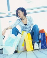 Tired Female Shopper with Bags